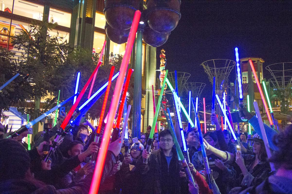 "Fans of Carrie Fisher honored her passing with a Star Wars light saber vigil in Downtown Disney. At 7 p.m. the fans all turned their light sabers on and pointed them to the sky while organizer Jeff Rowan of Anaheim intoned ""To Carrie Fisher, our Princess Leia, and to her mother, Debbie Reynolds, who passed away today."" Fisher died yesterday. (Photo by Mark Eades, Orange County Register/SCNG) Taken in Anaheim at Downtown Disney on Wednesday, December 28, 2016."
