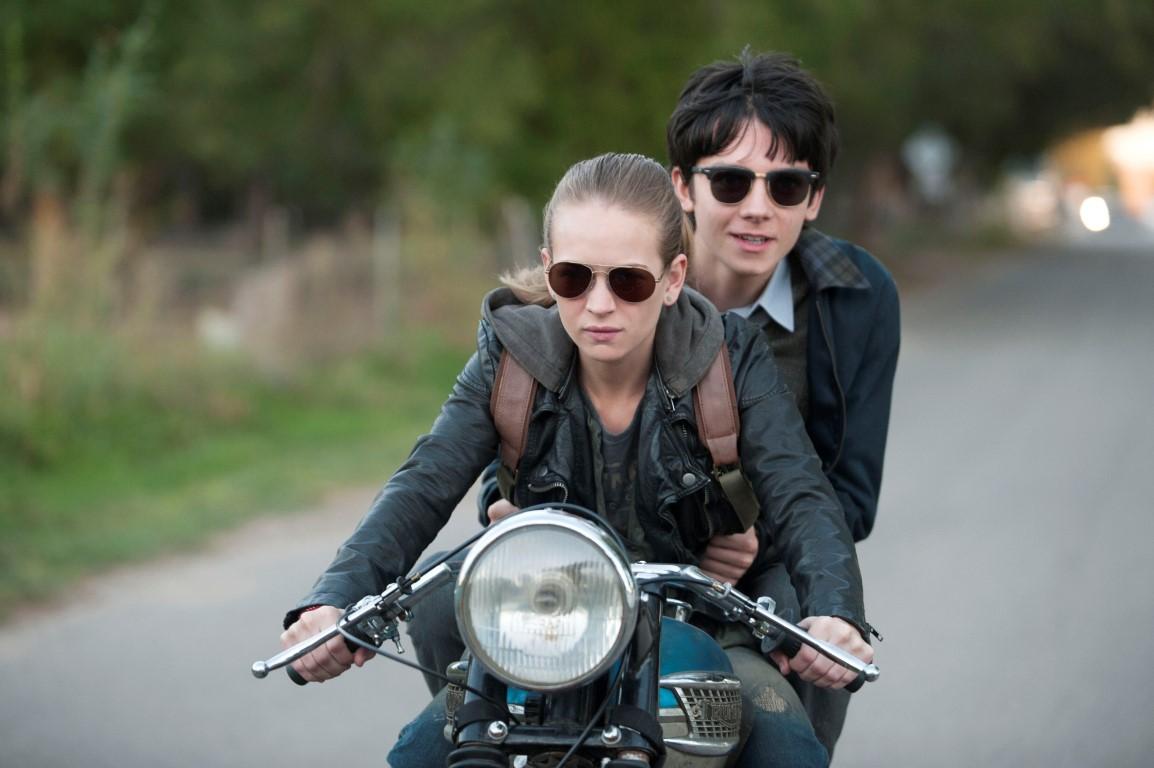 Tulsa (Britt Robertson) rides with Gardner (Asa Butterfield) on her motorcycle