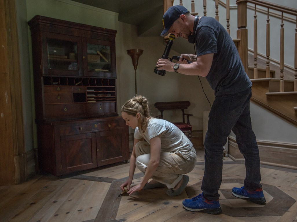 Left to right: Jennifer Lawrence and Director Darren Aronofsky on the set of mother!, from Paramount Pictures and Protozoa Pictures.