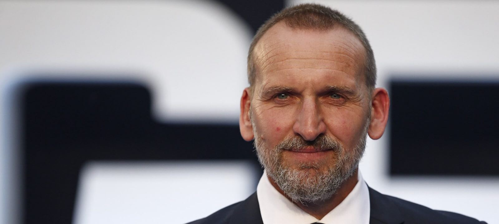 """British actor Christopher Ecclestone poses for pictures on the red carpet after arriving to attend the world premier of """"Legend"""" in central London on September 3, 2015.    AFP PHOTO / JUSTIN TALLIS        (Photo credit should read JUSTIN TALLIS/AFP/Getty Images)"""