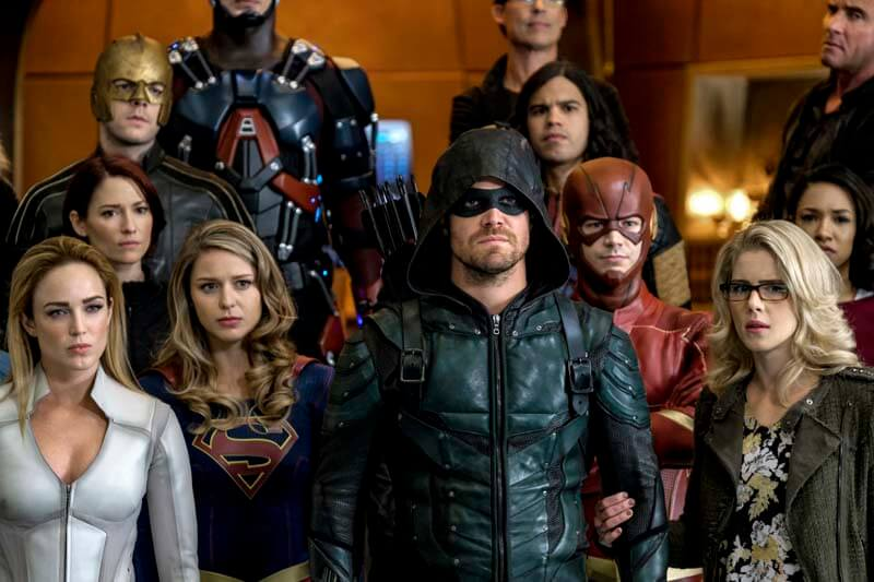 "DC's Legends of Tomorrow -- ""Crisis on Earth -- X, Part 4"" -- Image Number: LGN308b_0059b.jpg -- Pictured (L-R) (TOP): Russell Tovey as The Ray/Ray Terrill,Carlos Valdes as Cisco Ramon/Vibe and Dominic Purcell as Mick Rory/Heat Wave (Middle) Chyler Leigh as Alex Danvers, Grant Gustin as Barry Allen/The Flash and Candice Patton as Iris  West (BOTTOM): Caity Lotz as Sara Lance/White Canary, Melissa Benoist as Kara/Supergirl, Stephen Amell as Oliver Queen/Green Arrow and Emily Bett Rickards as Felicity Smoak -- Photo: Robert Falconer/The CW -- © 2017 The CW Network, LLC. All Rights Reserved."