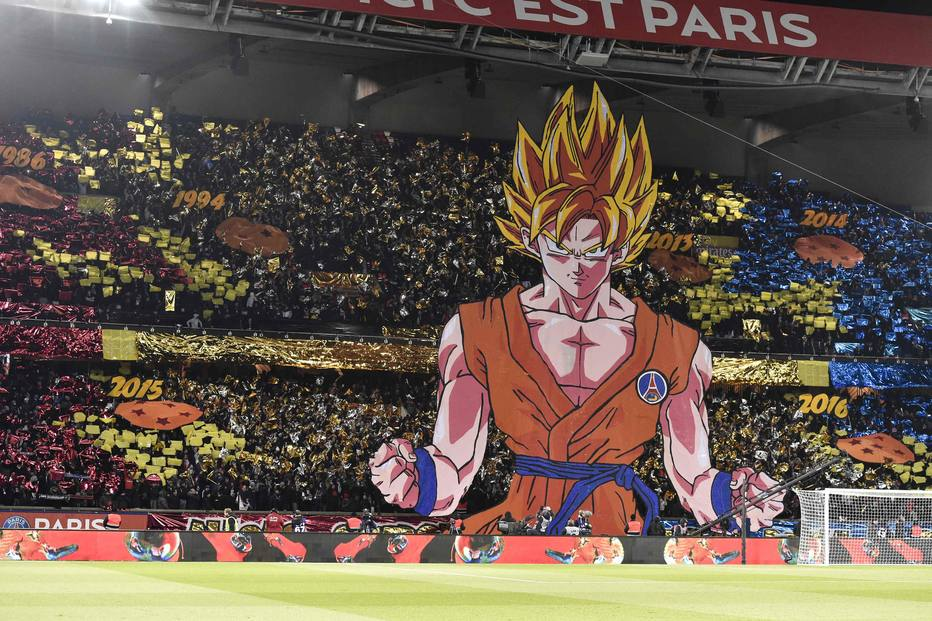 Paris Saint-Germain's supporters hold a tifo representing a character of Japanese manga Dragon ball prior to the French L1 football match between Paris Saint-Germain (PSG) and Marseille (OM) at the Parc des Princes in Paris on February 25, 2018.  / AFP PHOTO / GERARD JULIEN