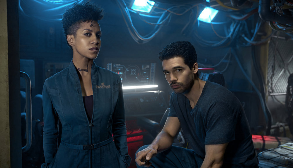 THE EXPANSE -- Season:2 -- Pictured: (l-r) Dominique Tipper as Naomi Nagata, Steven Strait as Earther James Holden -- (Photo by: Kurt Iswarienko/Syfy)
