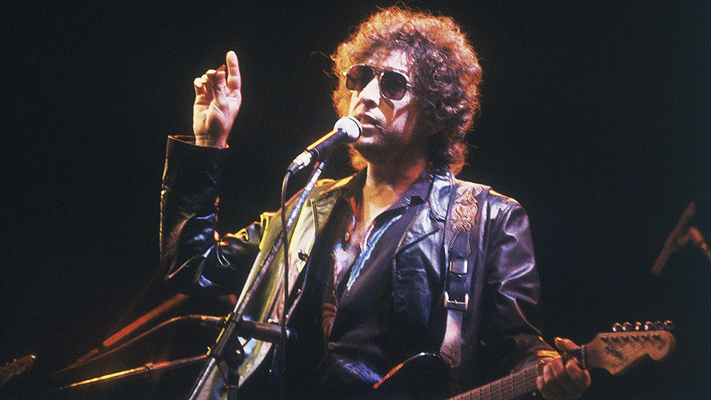 Mandatory Credit: Photo by Anonymous/AP/REX/Shutterstock (7324424b) American singer Bob Dylan performs at the Olympic Stadium in Colombes, France, before an estimated 40,000 fans Bob Dylan