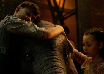 "TRUE LOVE -- When former circus star Holt Farrier (Colin Farrell) is charged with taking care of a newborn elephant whose oversized ears make him a laughingstock in an already struggling circus, he's surprised by just how quickly his children (Finley Hobbins and Nico Parker) fall for the peculiar pachyderm. Directed by Tim Burton and produced by Katterli Frauenfelder, Derek Frey, Ehren Kruger and Justin Springer, Disney's all-new, live-action reimagining of ""Dumbo"" flies into theaters on March 29, 2019. © 2018 Disney Enterprises, Inc. All Rights Reserved."